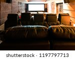home theater with big screen.  | Shutterstock . vector #1197797713