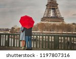 autumn in paris  couple under... | Shutterstock . vector #1197807316
