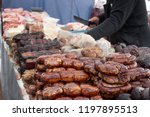 sausage on a market stand. | Shutterstock . vector #1197895513