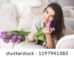 young attractive woman holding... | Shutterstock . vector #1197941383