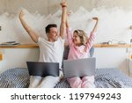 young couple on bed in morning  ... | Shutterstock . vector #1197949243