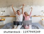 young couple on bed in morning  ... | Shutterstock . vector #1197949249