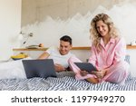 young attractive couple sitting ... | Shutterstock . vector #1197949270