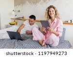 young couple on bed in morning  ... | Shutterstock . vector #1197949273