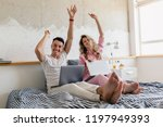 young couple having fun on bed... | Shutterstock . vector #1197949393