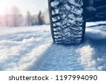 closeup of car tires in winter... | Shutterstock . vector #1197994090