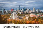 Small photo of Skyline of Edmonton - capital of Alberta, the oil city, on North Saskatchewan River during colourful, vivid autumn, fall. Sunny day, panorama layout.