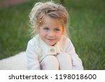 girl with blond hair  cute... | Shutterstock . vector #1198018600