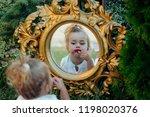 kid model put red lipstick on...   Shutterstock . vector #1198020376