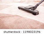 vacuum cleaner in the room on... | Shutterstock . vector #1198023196