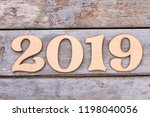 wooden number 2019 on old... | Shutterstock . vector #1198040056