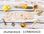 number 2019 and christmas... | Shutterstock . vector #1198042423