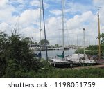 classic sailboats docked on a... | Shutterstock . vector #1198051759