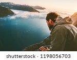 man alone on the edge cliff... | Shutterstock . vector #1198056703