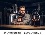 tattooed hipster male with... | Shutterstock . vector #1198090576