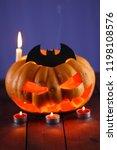 halloween pumpkin. candles  bat ... | Shutterstock . vector #1198108576