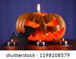 halloween pumpkin. candles  bat ... | Shutterstock . vector #1198108579