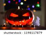 halloween pumpkin. candles  bat ... | Shutterstock . vector #1198117879