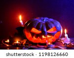 halloween. glowing pumpkin in... | Shutterstock . vector #1198126660