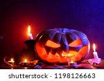 halloween. glowing pumpkin in... | Shutterstock . vector #1198126663