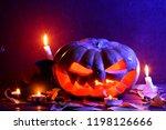 halloween. glowing pumpkin in... | Shutterstock . vector #1198126666