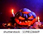halloween. glowing pumpkin in... | Shutterstock . vector #1198126669