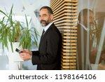 handsome middle age businessman ... | Shutterstock . vector #1198164106