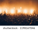 silhouettes of concert crowd in ... | Shutterstock . vector #1198167046
