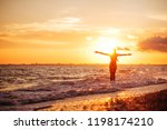 carefree woman dancing in the... | Shutterstock . vector #1198174210