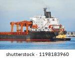 tugboat assisting bulk cargo... | Shutterstock . vector #1198183960
