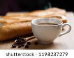 cup of coffee and baguette... | Shutterstock . vector #1198237279