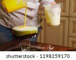 cook preparing mousse cake... | Shutterstock . vector #1198259170