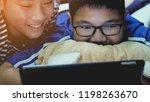 happy asian preteens watching... | Shutterstock . vector #1198263670