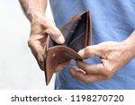 hand of senior open pocket  no... | Shutterstock . vector #1198270720