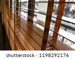 open brown wooden shutters... | Shutterstock . vector #1198292176