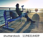 man waiting with poles and... | Shutterstock . vector #1198314409