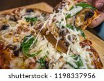 homemade pizza close up. | Shutterstock . vector #1198337956