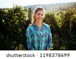 woman winemaker with grapes in... | Shutterstock . vector #1198378699
