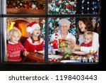 family with children eating... | Shutterstock . vector #1198403443