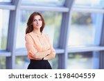 modern business woman standing...   Shutterstock . vector #1198404559