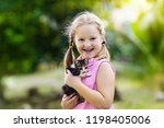 child holding baby cat. kids... | Shutterstock . vector #1198405006
