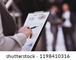 close up. accountant checking...   Shutterstock . vector #1198410316