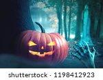 halloween pumpkins on wood in a ... | Shutterstock . vector #1198412923
