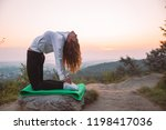 woman do yoga exercises at top... | Shutterstock . vector #1198417036