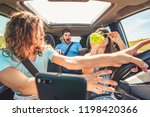 group of people in car. woman... | Shutterstock . vector #1198420366