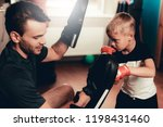 father and son boxing exercises ... | Shutterstock . vector #1198431460