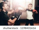 father and son boxing exercises ... | Shutterstock . vector #1198431616