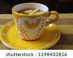 cup of tasty hot fresh apple tea | Shutterstock . vector #1198432816