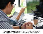 programmer working in a... | Shutterstock . vector #1198434820