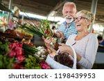 smiling senior couple holding... | Shutterstock . vector #1198439953